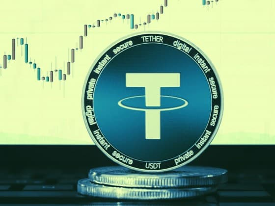 Tether coin placed in front of candle graph