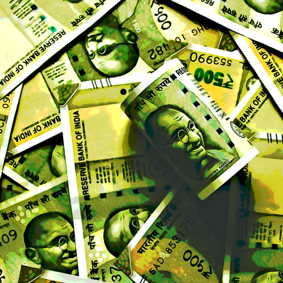 Indian rupees scattered on flat surface