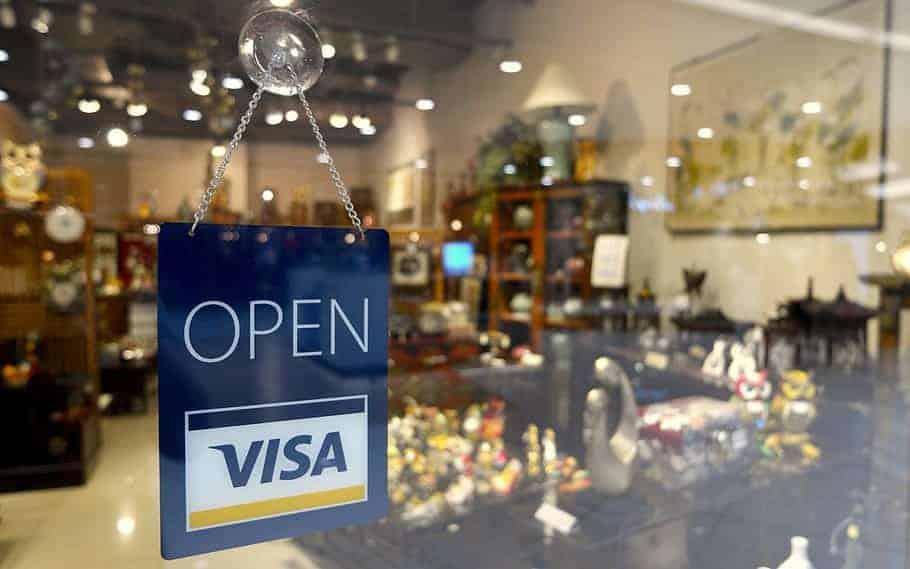 Visa sponsored 'open' sign at shopfront
