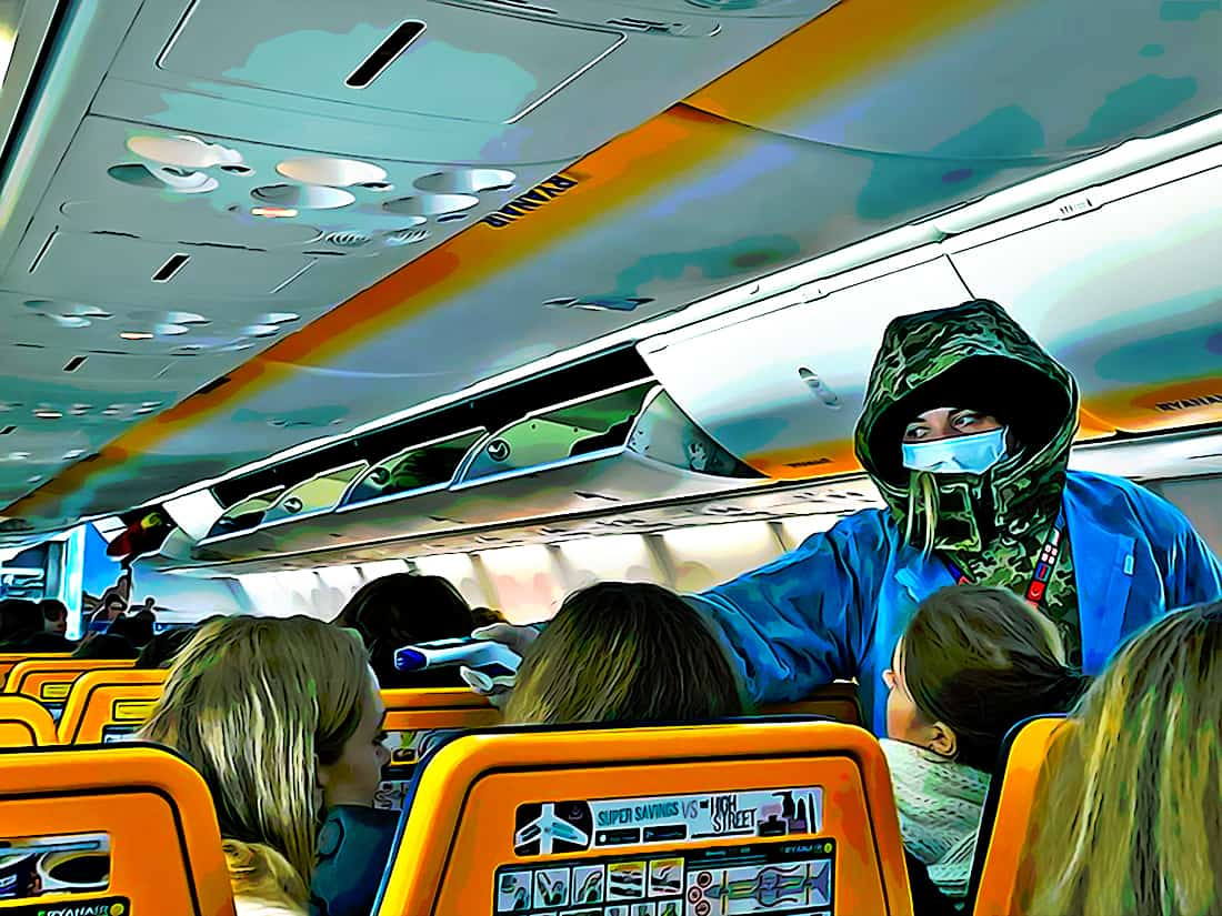 Passengers get temperatures checked on airplane. blockchain covid travel