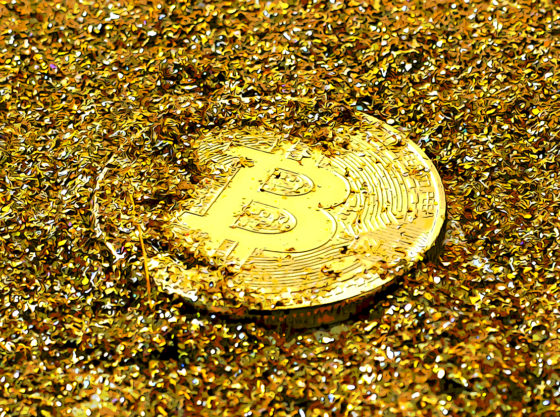 Bitcoin covered in gold shavings