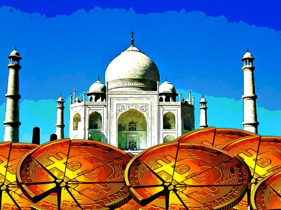 Crack bitcoin stacked in front of Taj Mahal