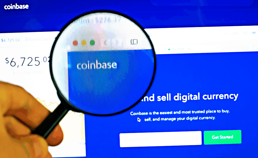 Man holds magnifying glass over Coinbase logo on Coinbase website