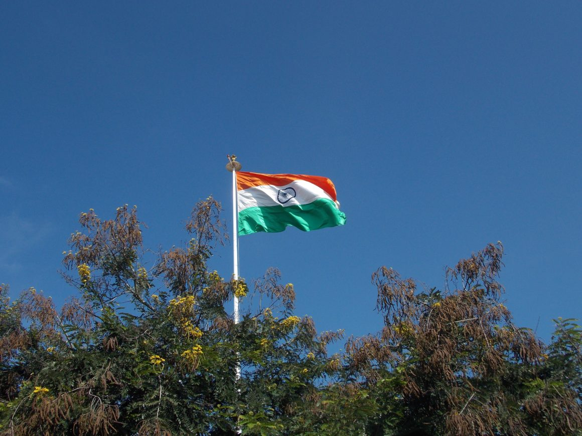 Indian flag waving high above trees
