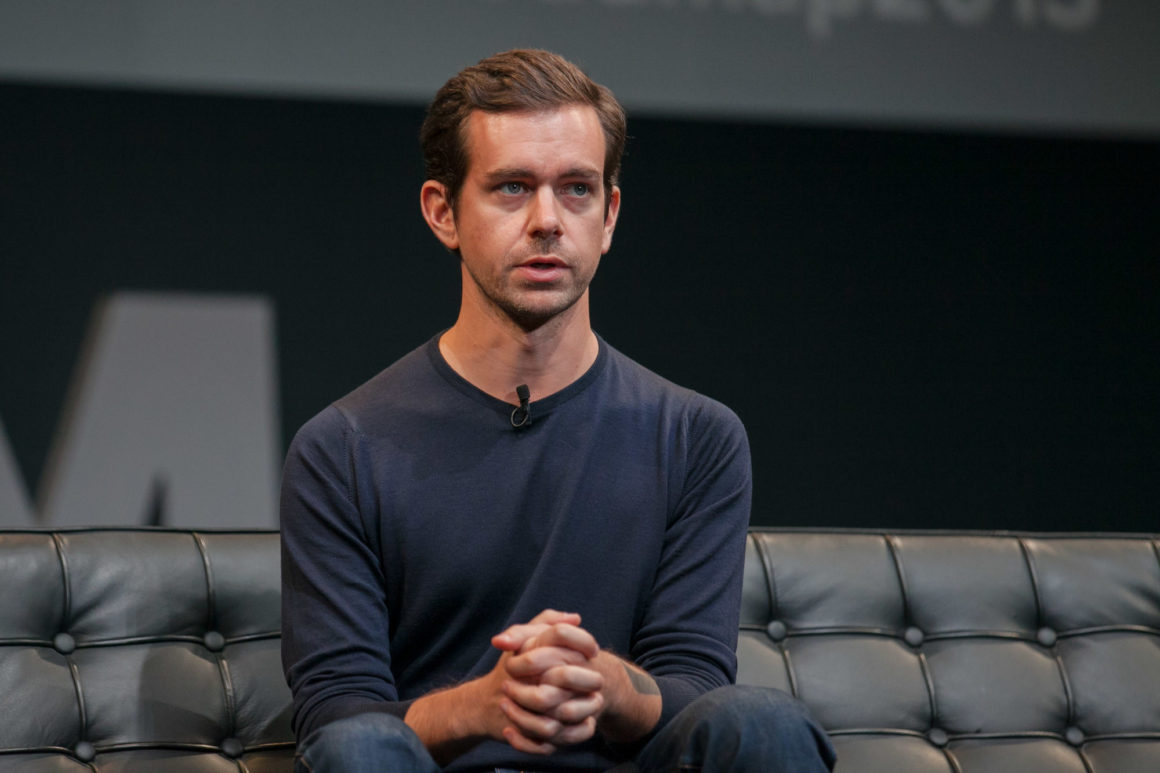 Twitter CEO Jack Dorsey sitting on a couch during a live event