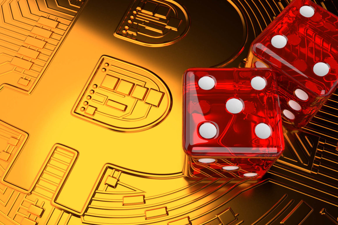 Two dice on top of Bitcoin