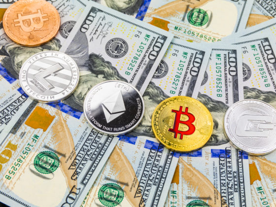 US not in CBDC rush: Symbolic coins of bitcoin on banknotes of one hundred dollars. Exchange bitcoin cash for a dollar.