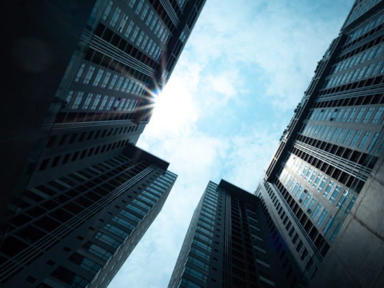 Upwards view of Hong Kong skyscrapers. Virtual asset service providers or VASPs ready to professionalize and grow.