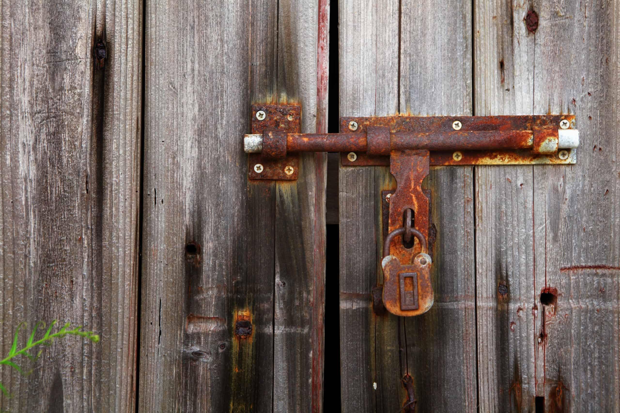 old lock on closed door 2XT3JRX scaled