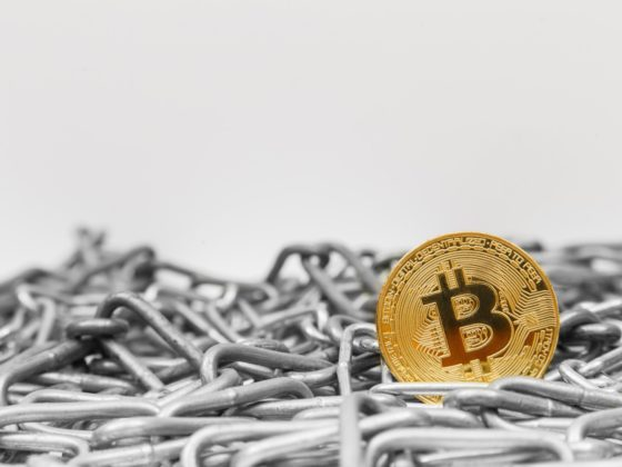 Bitcoin sitting in a pile of chains | China tightens supervision on crypto