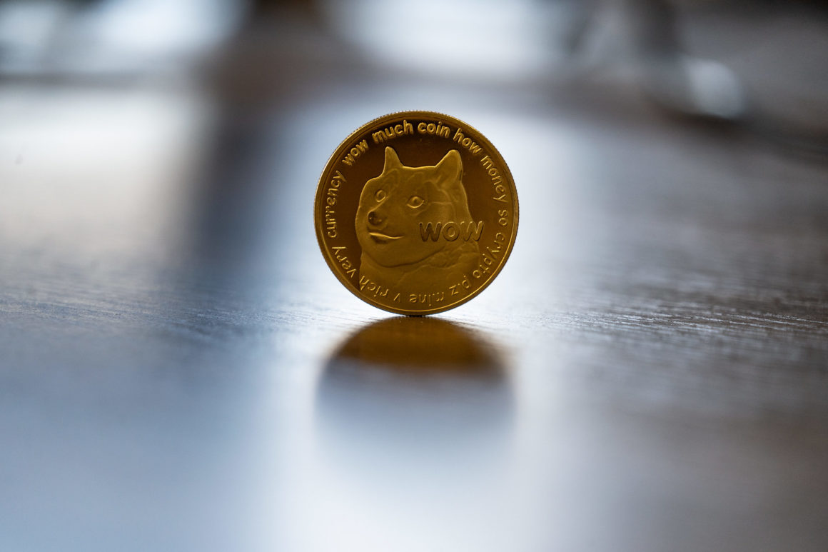 Dogecoin medallion balancing on its side