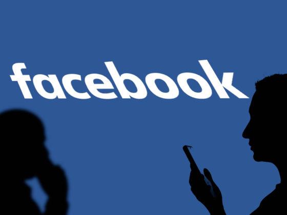 Silhouette of people in front of Facebook logo | Diem CBDC