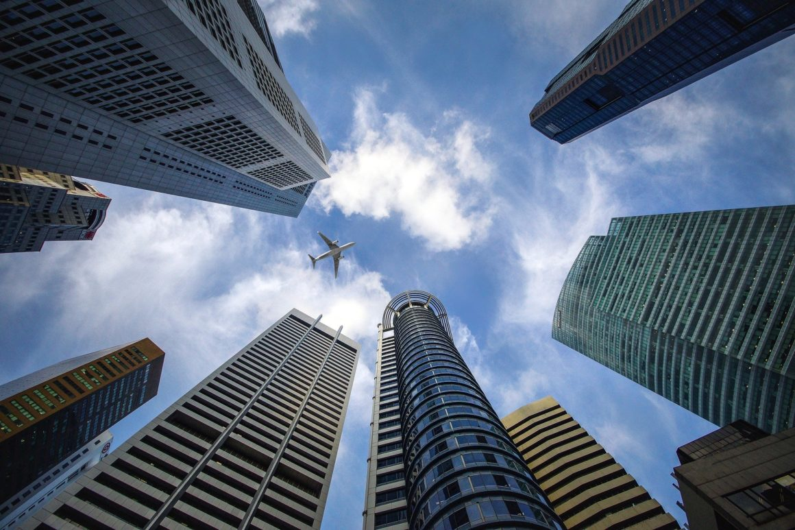 Ground up view of Singapore skyscrapers. J.P. Morgan, DBS Bank and Temasek partner on 'game-changing' blockchain for payments.