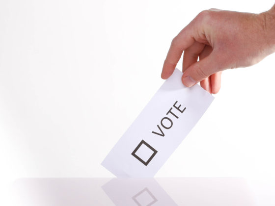 Hand submits a vote | How blockchain technology can improve trust in democratic elections