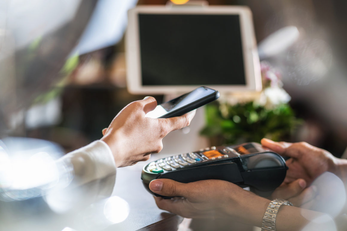 China's internet giants JD.com and Ant Group further facilitate DCEP development | Closeup Asian customer man hand paying money via contactless cha