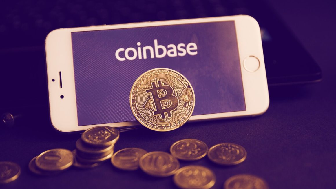 Picture of bitcoin in front of Coinbase logo displayed on mobile phoe