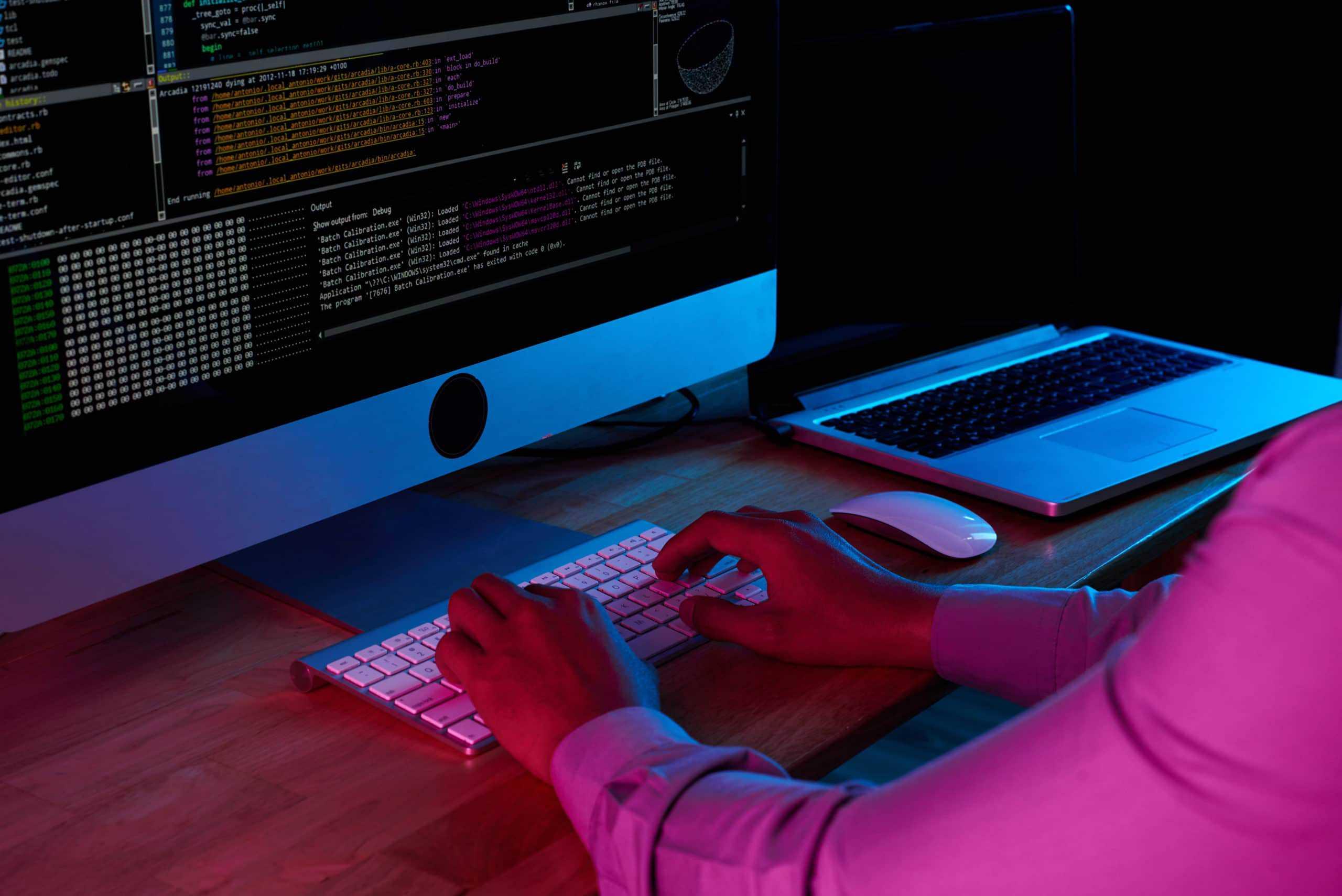 male hacker stealing data HCLSABP scaled