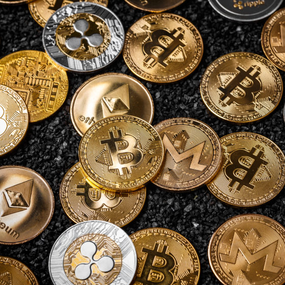 Asian governments urge 'extreme caution' before buying cryptocurrency. Photo of stack of cryptocurrencies including Bitcoin.