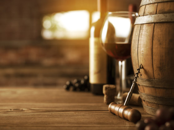 Wooden barrel and luxury wines in the cellar, wine culture concept
