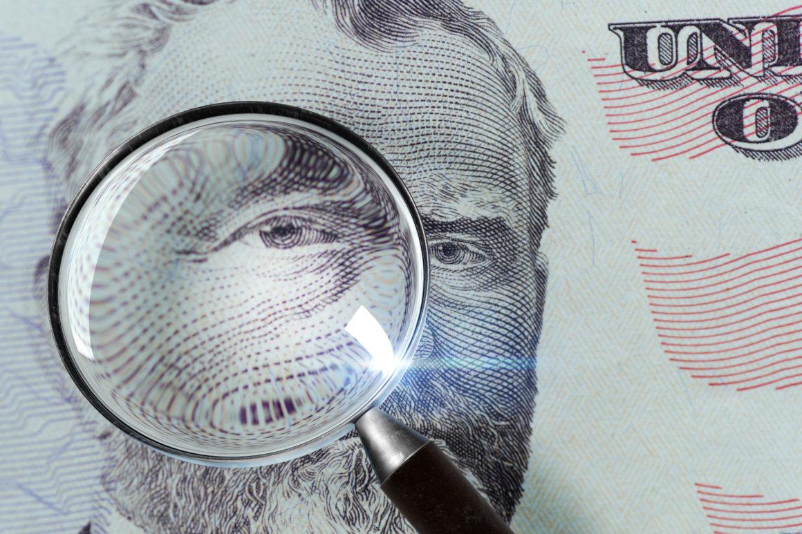 50-dollar bill under the magnifying glass