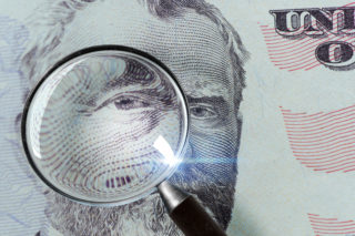 50-dollar bill under the magnifying glass