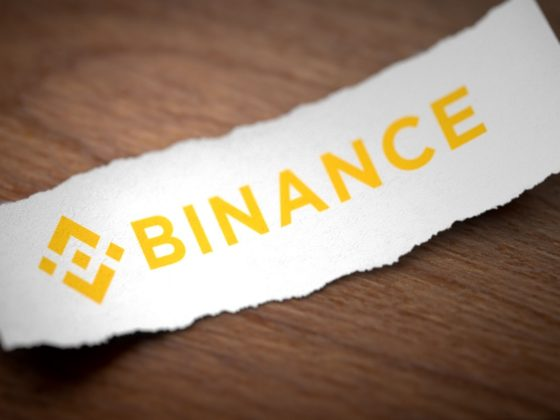 Binance logo on a torn strip of paper