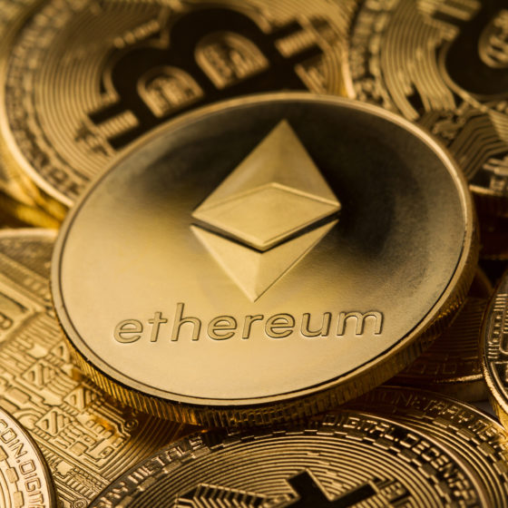 close up of ethereum on a stack of bitcoin golden coins | Ethereum ATH