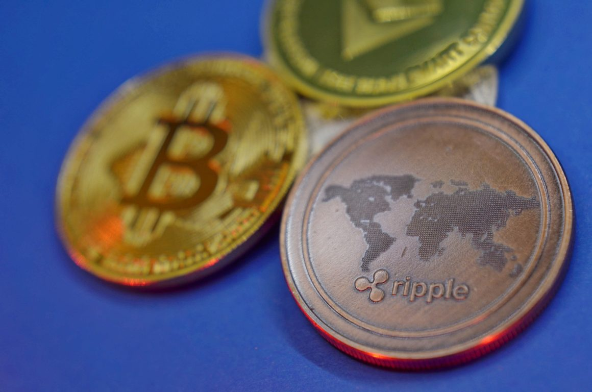 Ripple XRP coin, bitcoin and ethereum coin the background