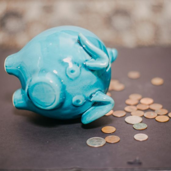 Piggy Bank with coins tipped over | crypto market crash