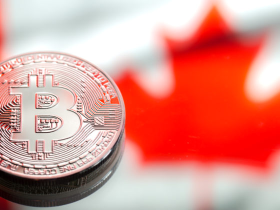 coins Bitcoin, against the background of Canada flag, concept of