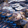 Cryptocurrency Polka DOT golden coins spilling on the table