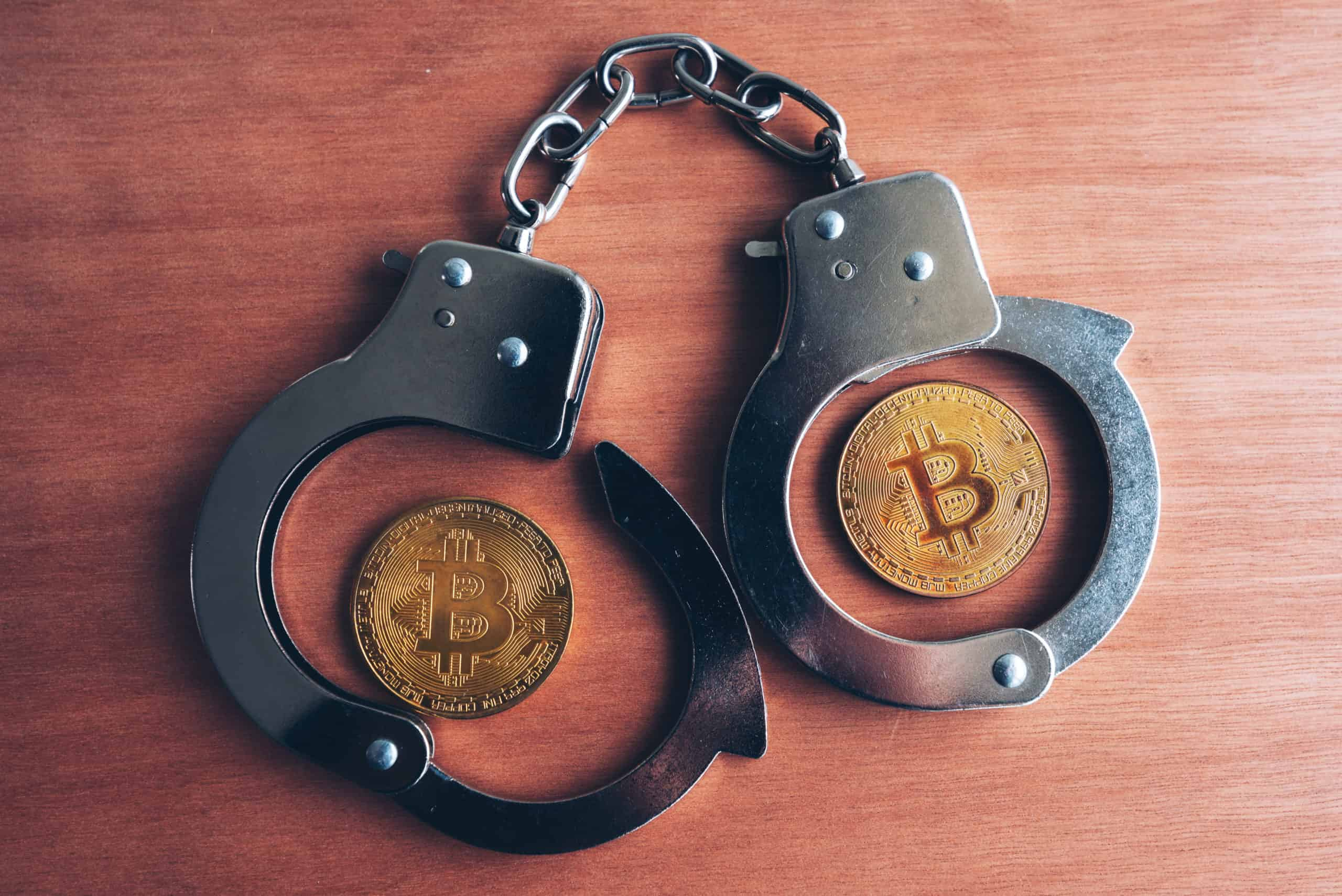 handcuffs and bitcoins P5G6UD4 scaled