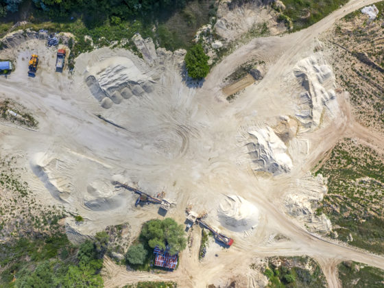 Top view on a quarry. Aerial view from drone on a mining of natural resources or ore