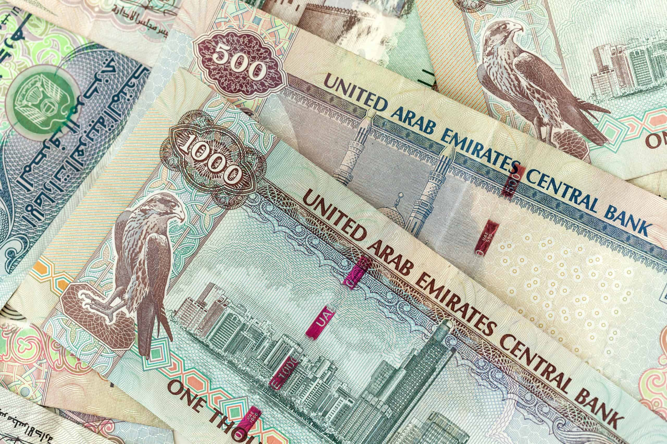 uae dirhams different banknotes close up top view UKVSJ79 scaled