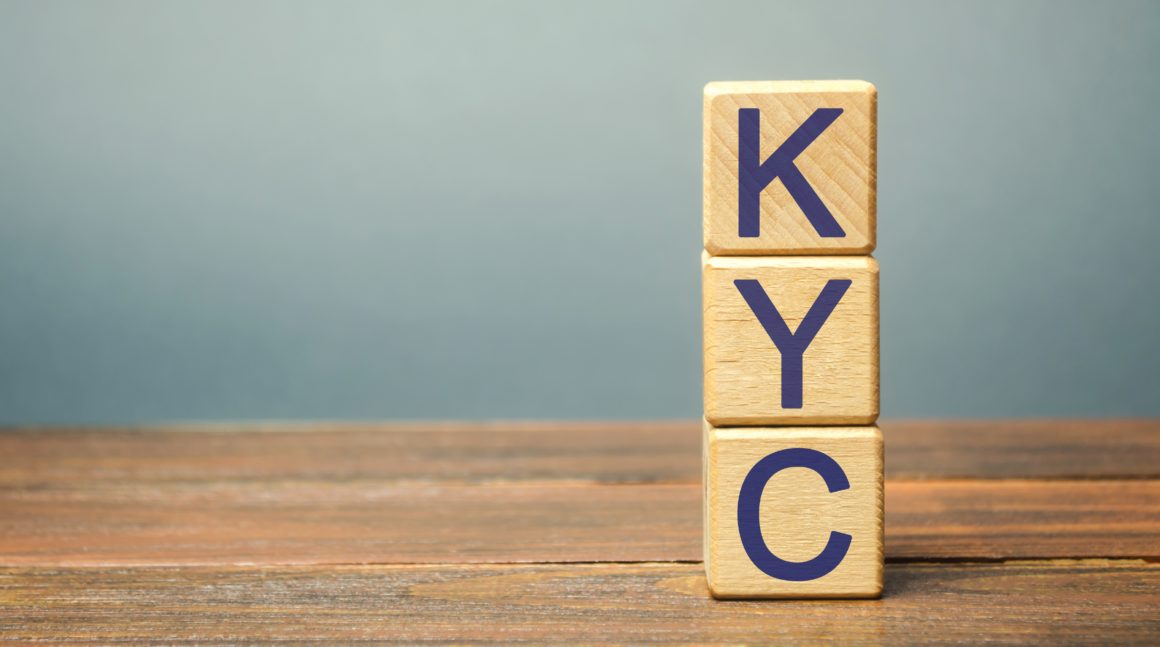 Wooden blocks with the word KYC - Know Your Customer