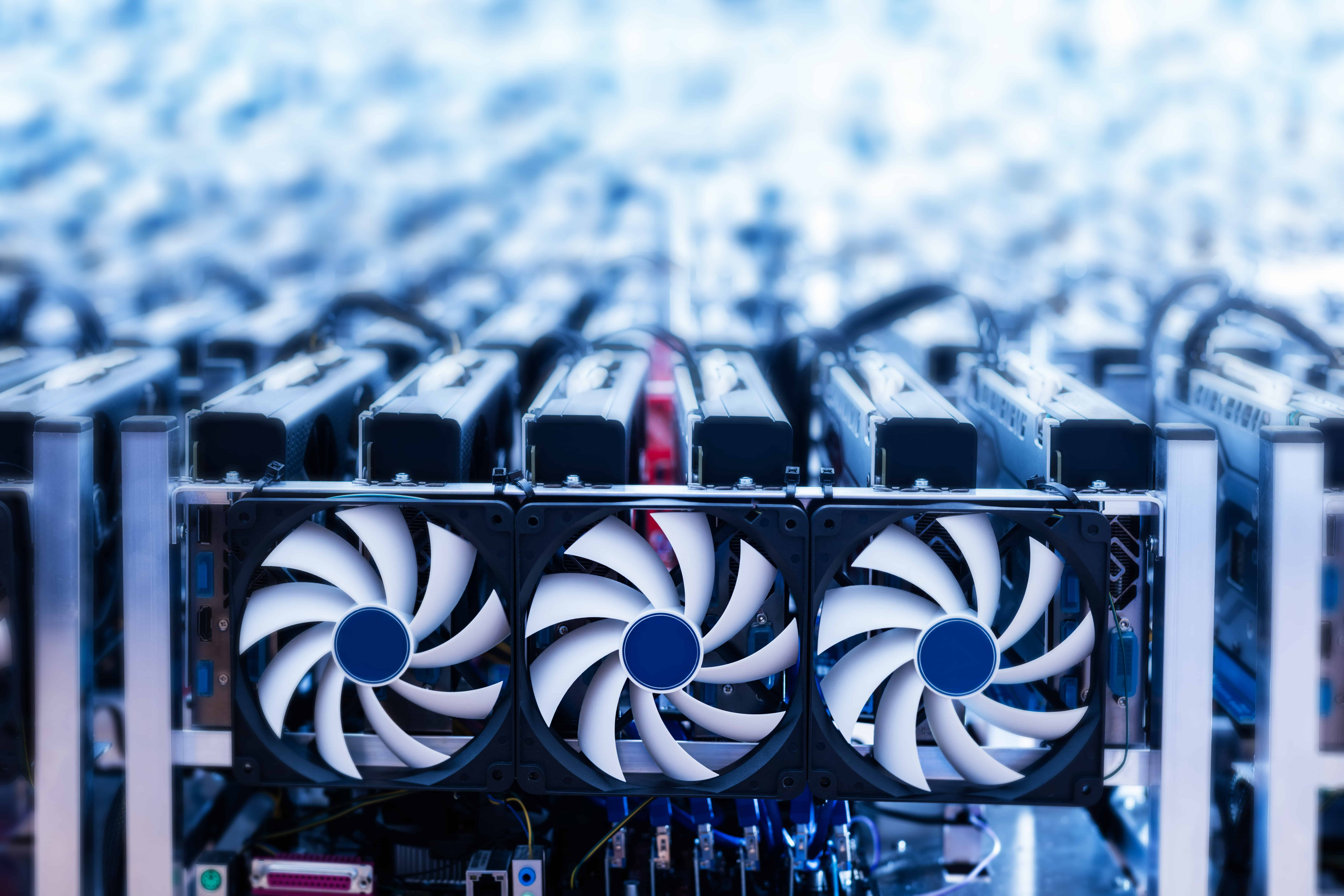 Bitcoin miner. Cryptocurrency mining machines. IT device with cooling fans. Technology.