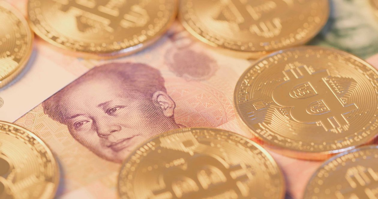 bitcoin over chinese banknote EE7Z7SD