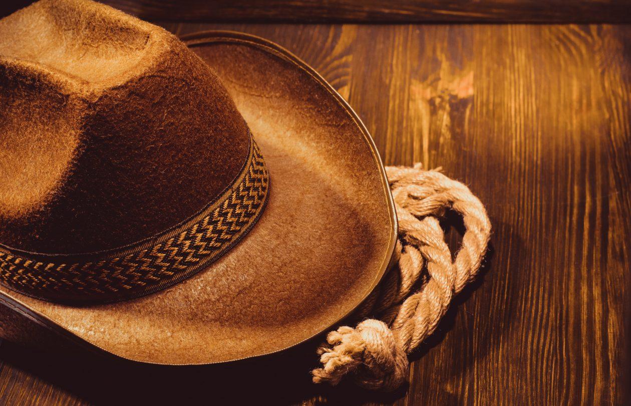 cowboy hat on wood PXCB9DA