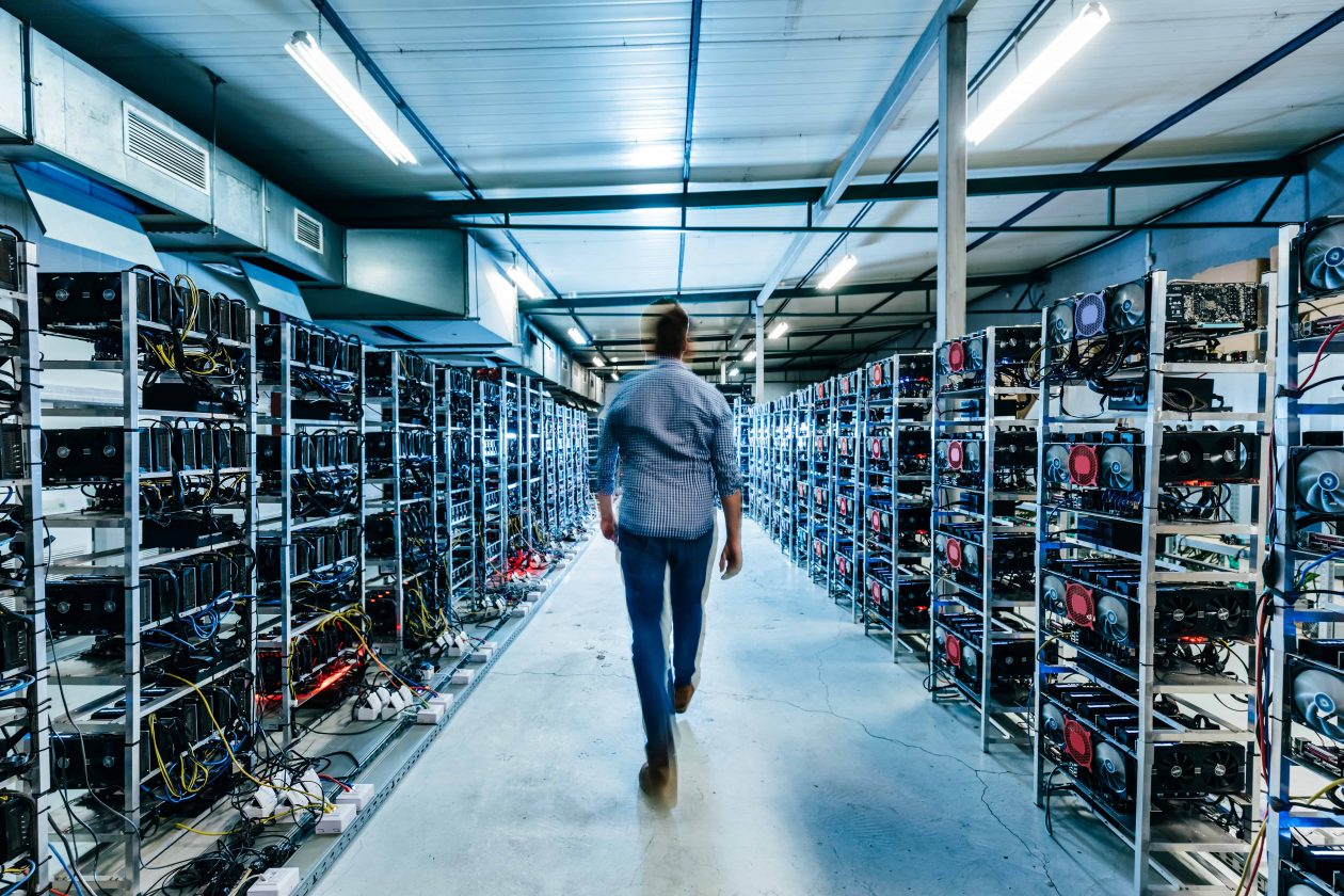 it business owner walking in high tech data center 2C2JX6F