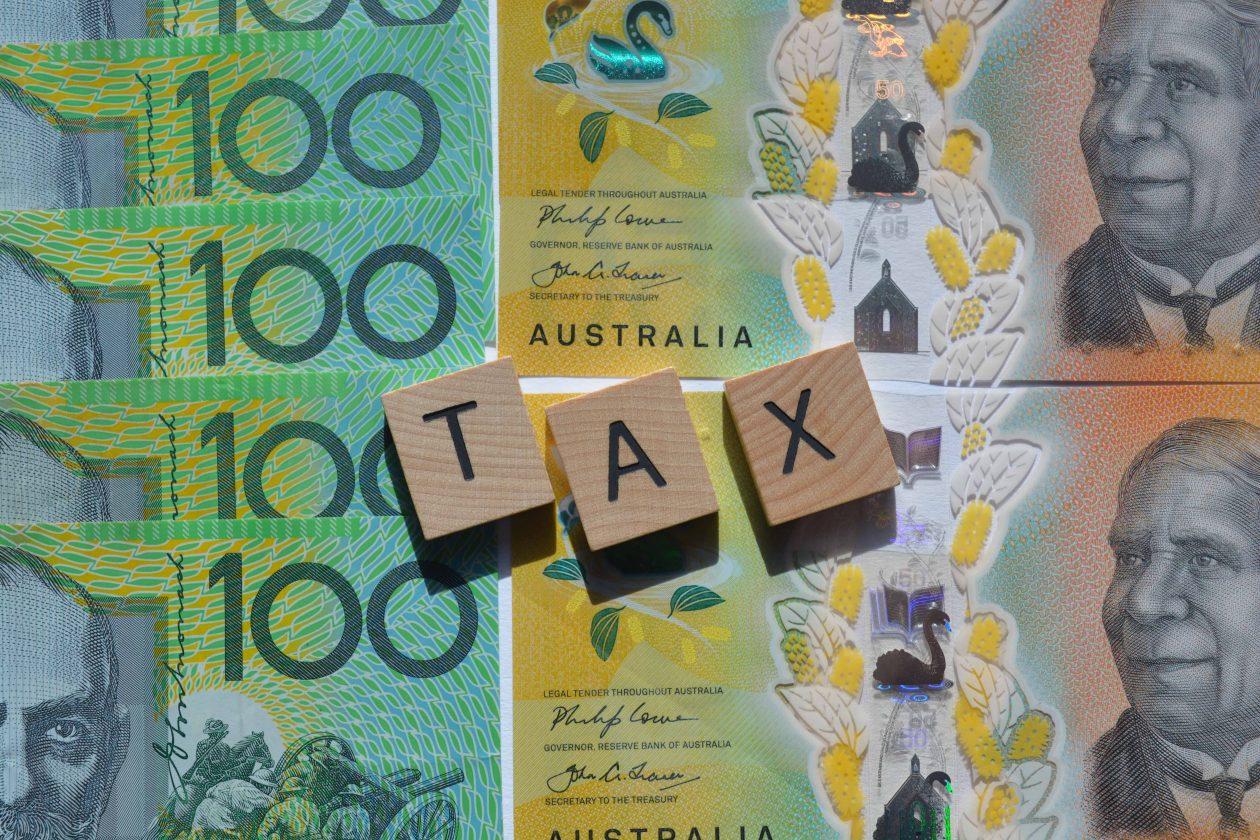 tax word in wood letters on top of australian high BSN7VQJ