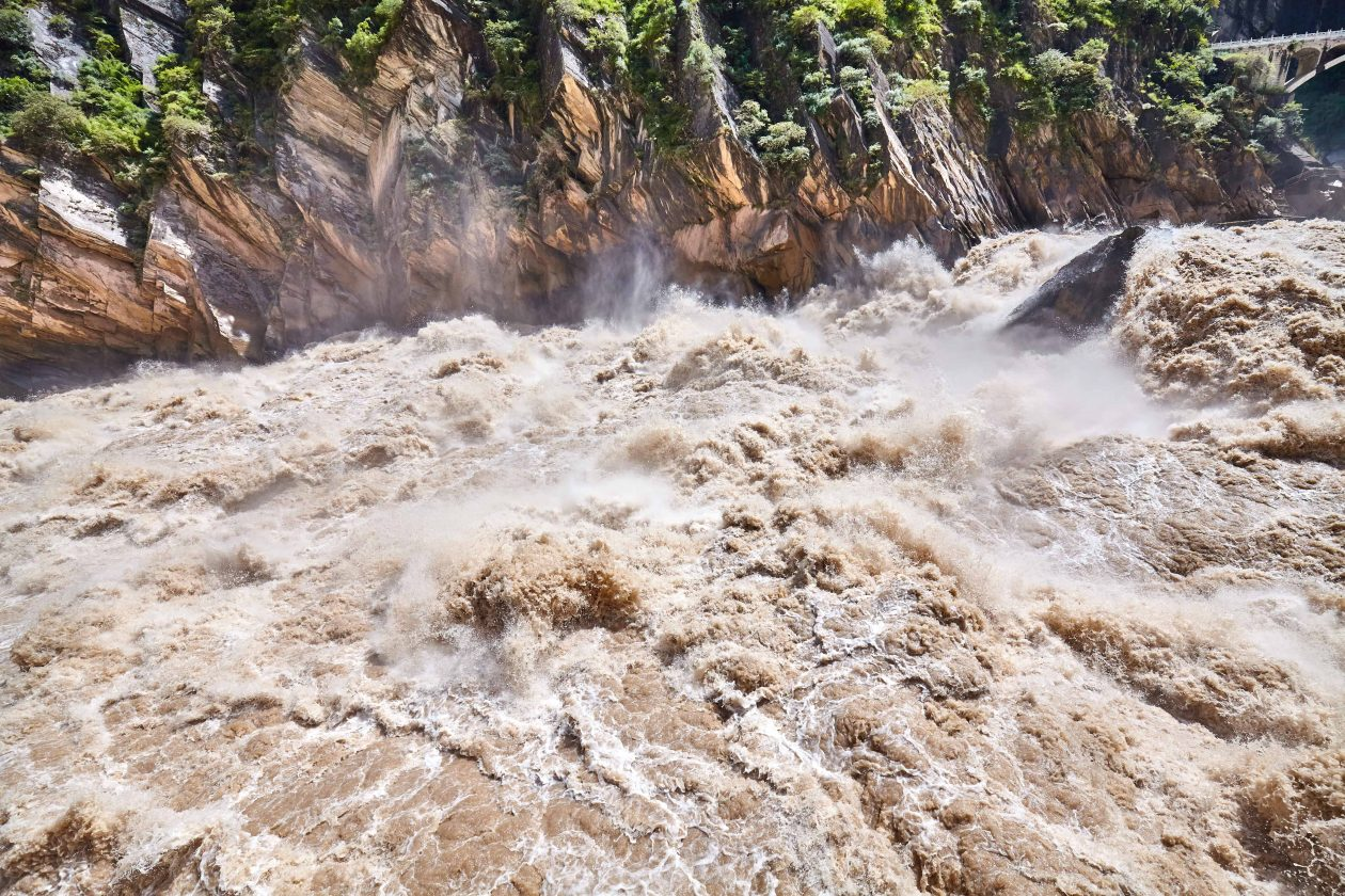 turbulent muddy mountain river GXUBYJK