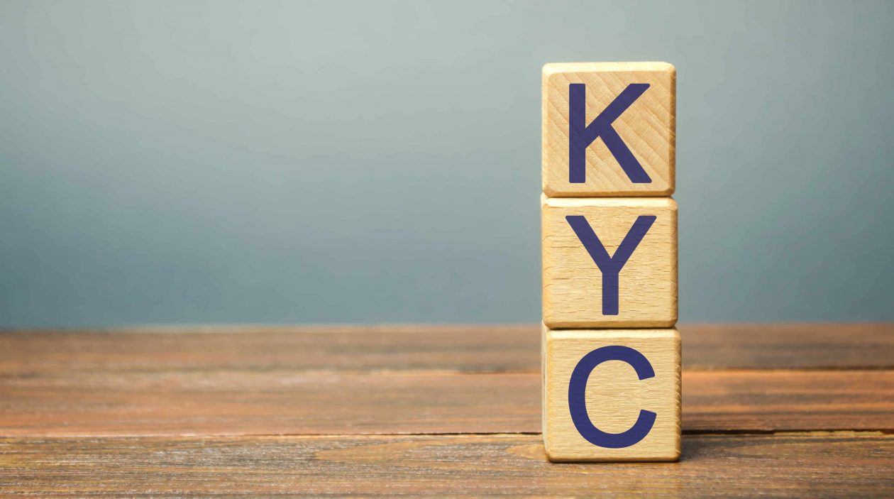wooden blocks with the word kyc know your customer RB9NZ4S