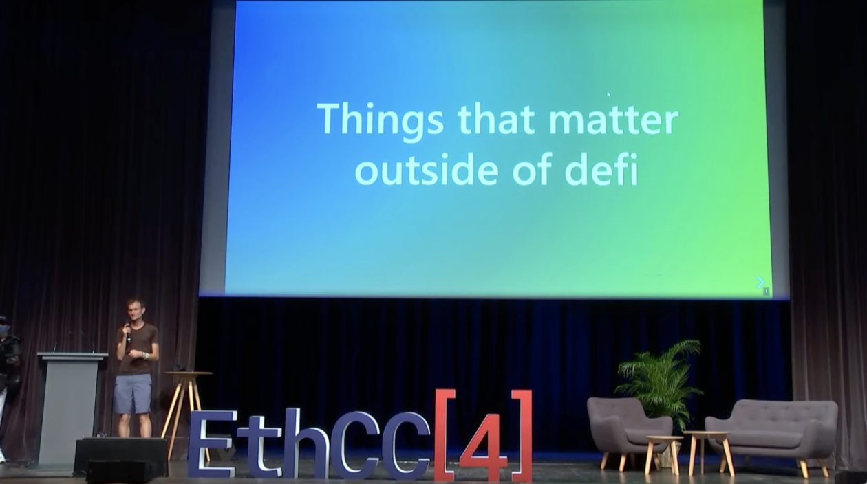"""Vitalik Buterin on the main stage of EthCC Paris, with a wide screen saying """"Things that matter outside of defi"""" behind him   Vitalik Buterin talks going beyond DeFi at EthCC4 Paris"""