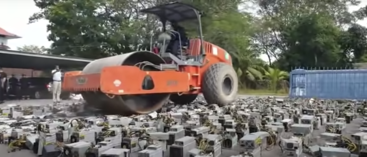 Borneo police use a giant steamroller to destroy 1,069 crypto mining rigs that had been using stolen electricity.