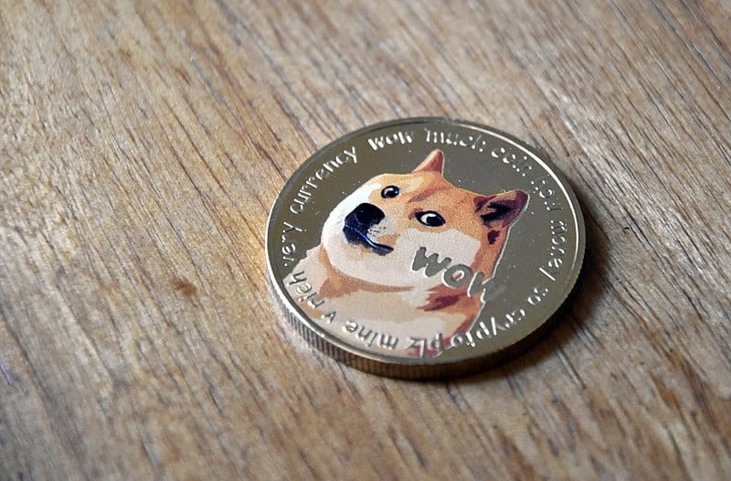 Dogecoin_gold_coin_on_wood_2_-_heads