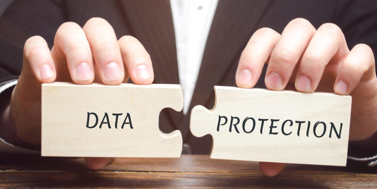 Data Protection on the wooden block, Decentralized technique helps to protect privacy