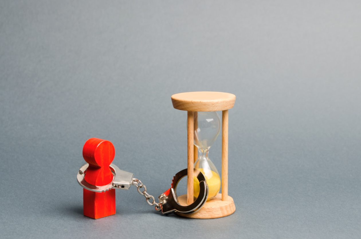 A wooden figure locked by a hourglass, users can only trade crypto asset after 24 hour freezing   Huobi freezes OTC trades