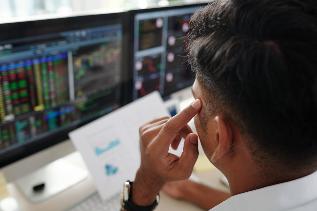 Trader thinking about stock market, the blcokchain can change the capital market