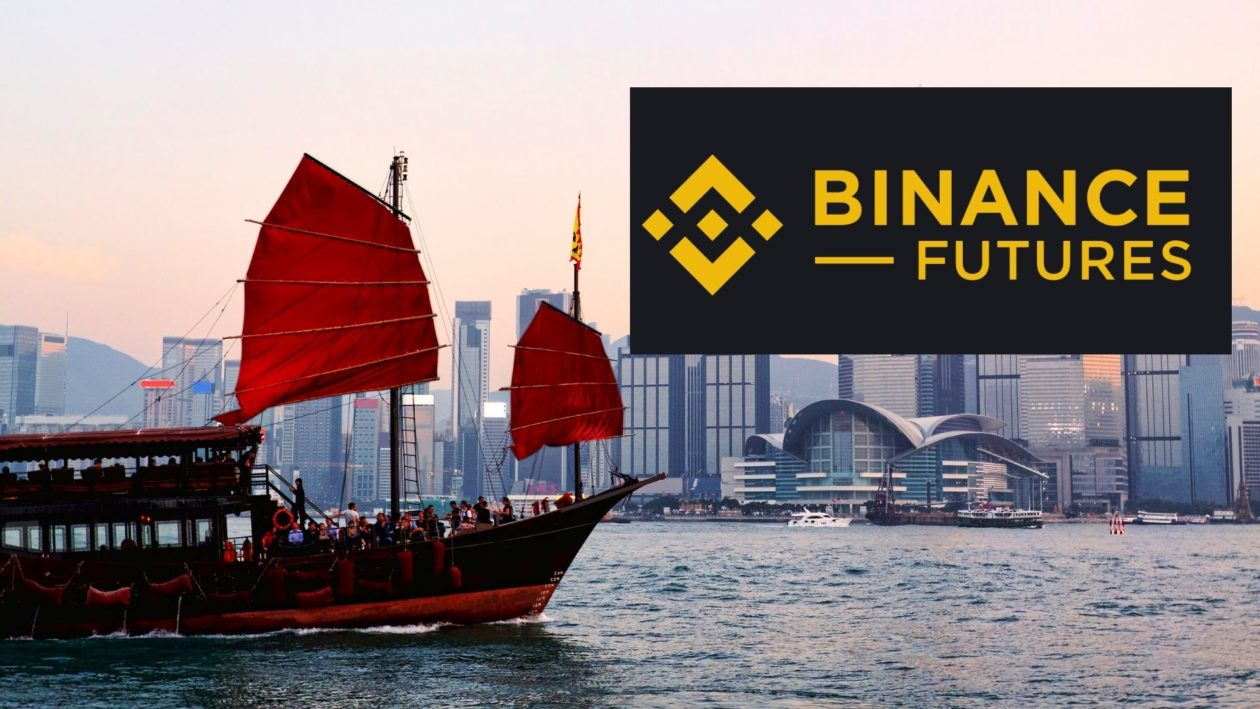 Binance logo and Hong Kong Victoria Harbour with boat