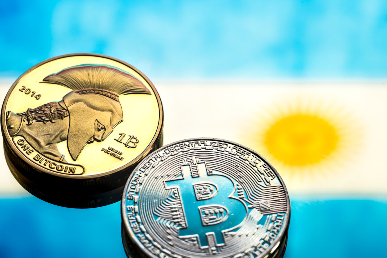 coins Bitcoin, against the background of Argentina flag, concept of virtual money, close-up. Conceptual image of digital crypto currency.